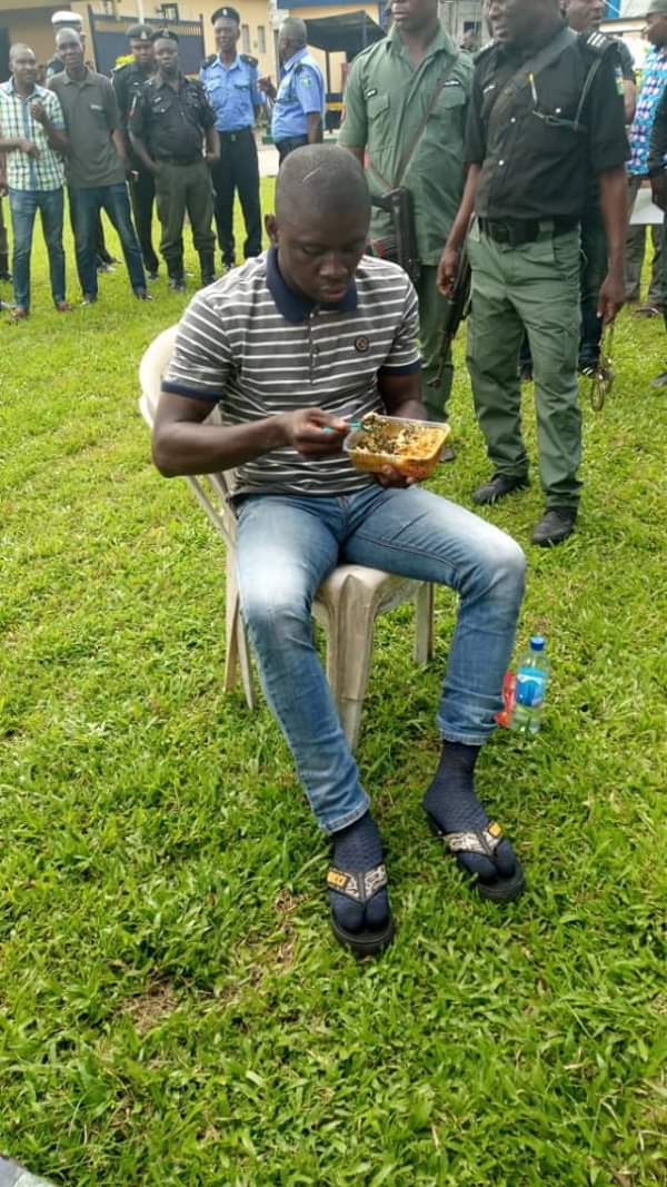 See The Moment Police Gave Port Harcourt Serial Killer Food As They Parade Him