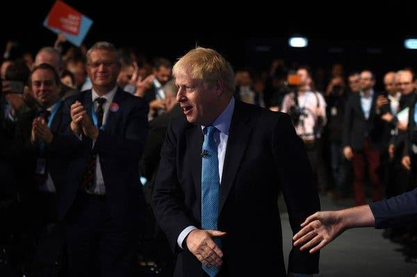 Boris Johnson Under Fire For Not Shaking The Hands Of Black