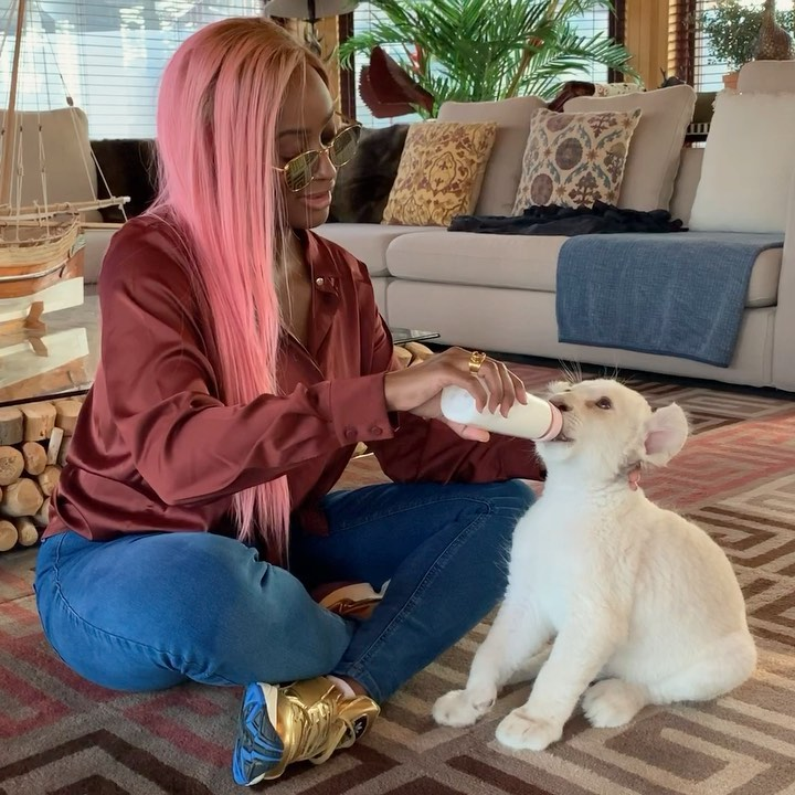 DJ Cuppy Feeds A Lion Named After Her