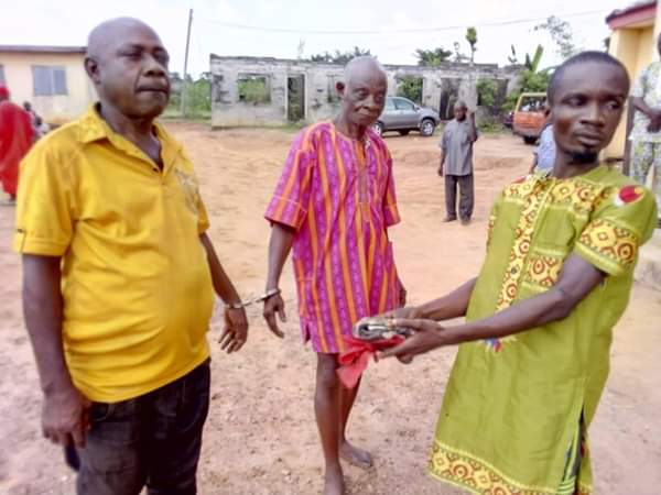 2 Men 'Killing People With Charms' In Anambra Caught & Handcuffed (Photos)