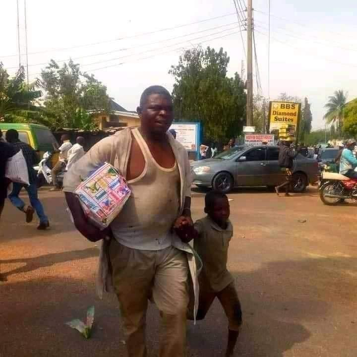 Father Took His Little Son To Loot In Kaduna (Photo) 2