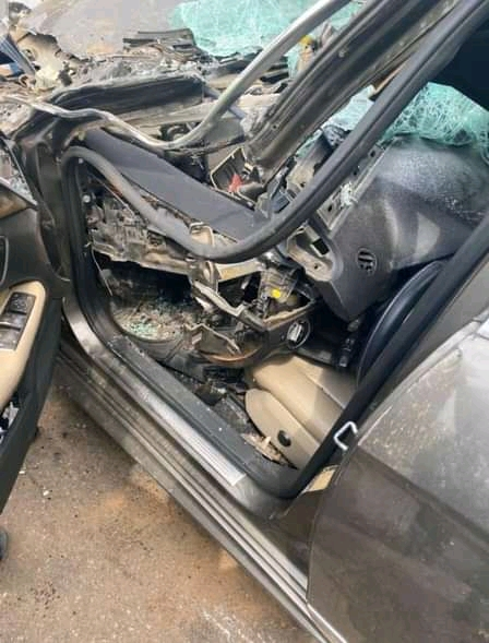 Man Survives After His Car Ran Under A Truck In Abuja