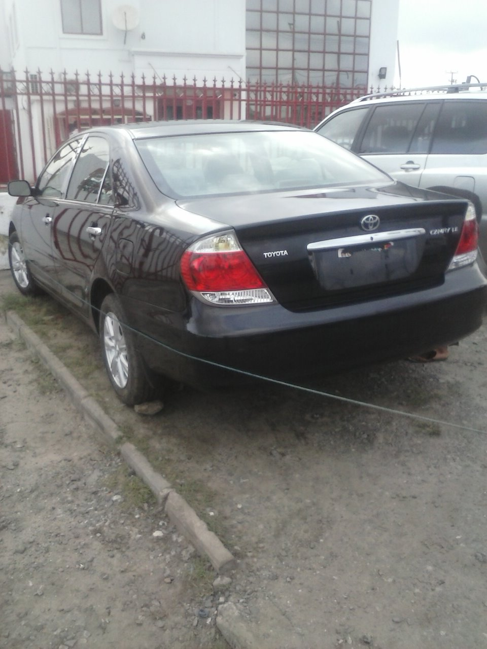 very clean black tokunbo toyota camry le 2006@1.69m(08096577304