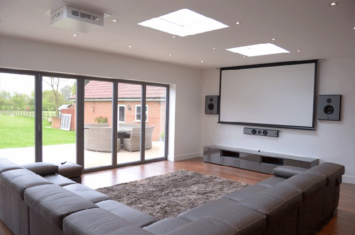 Install A Projector And Big Screen In Your Living Room To