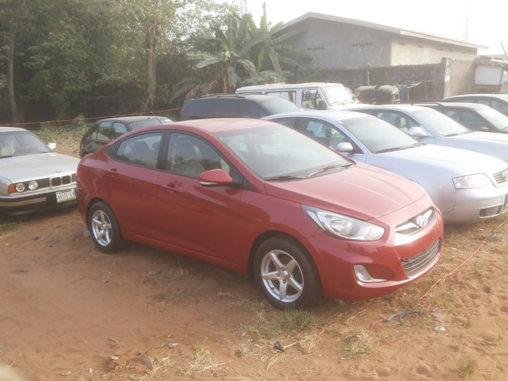 Hyundai Accent 013. Wine Red. Factory A/c Low Mileage. Fabric Alloy Rims.  In Very Good Condition. Price 1,800,000 Eighty Negotiable. Tel 08038651538