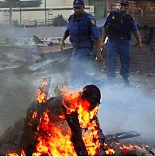 Photo Of South African Police Supervising The Burning To