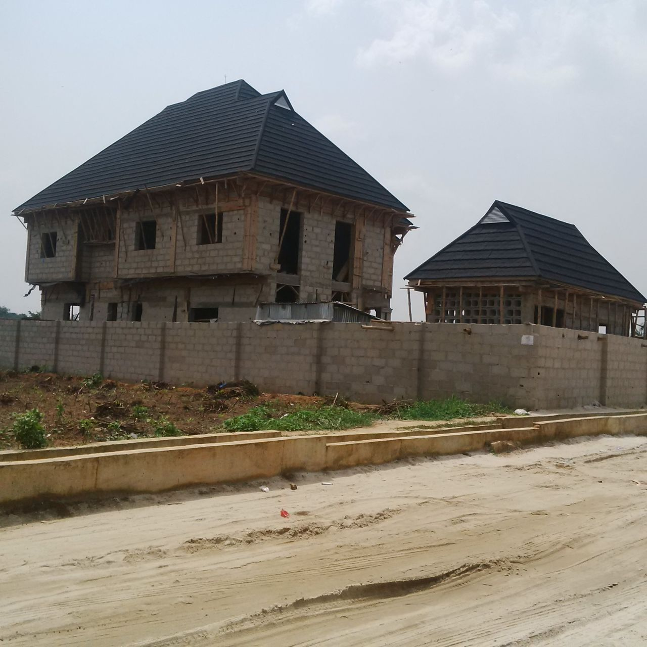 Pictures of some of our quality stone coated aluminium roofing sheets projects properties nigeria