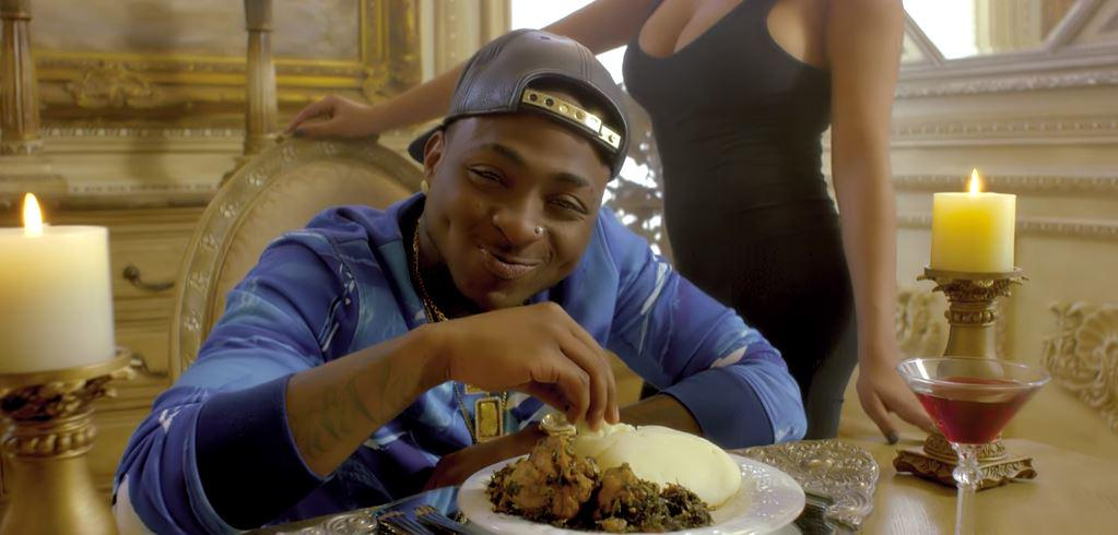Image result for black man eating pounded yam