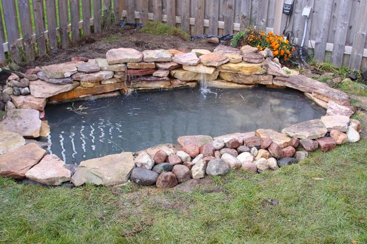 Garden design swimming pools water fall and koi ponds for Concrete fish pond construction and design