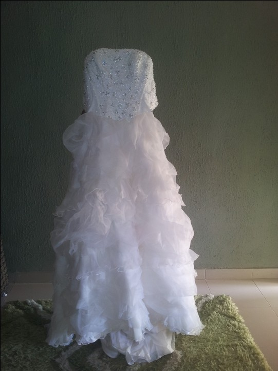 Used once wedding gown and aso oke fashion nigeria for Once used wedding dresses