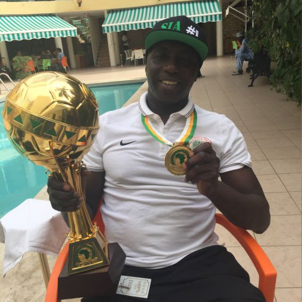 Siasia Shows Off The U-23 Trophy And His Medal (Photo)