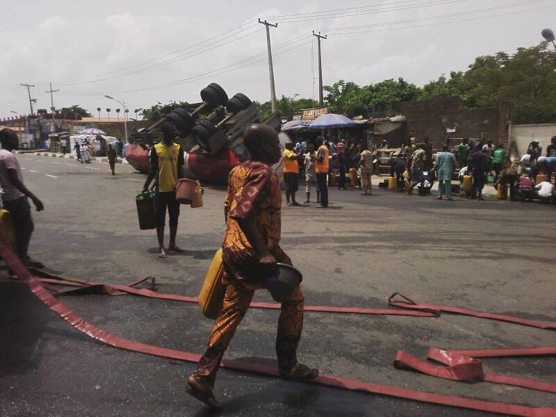 Fuel Scarcity: Nigerians Scoop Fuel From Fallen Petrol Tanker In Abeokuta (Photos)