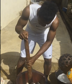 3750799_38_png8706fd84bdeda9d836fe70ea347366f3 Footballer, Onazi Ogenyi pictured pounding yam for his mum