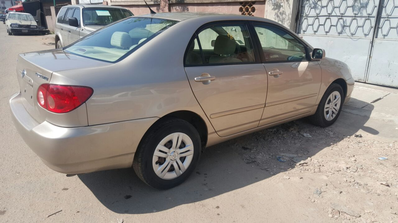 toyota corolla 2006 model gold colour toks lagos clearing for sale autos nigeria. Black Bedroom Furniture Sets. Home Design Ideas