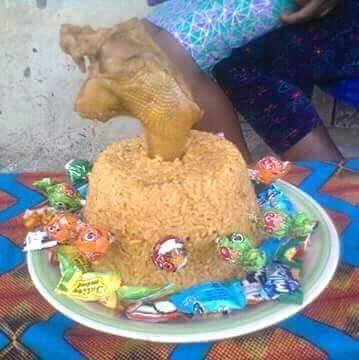See Rice And Chicken Birthday 'Cake' Nigerian Parents Used To Celebrate Their Child