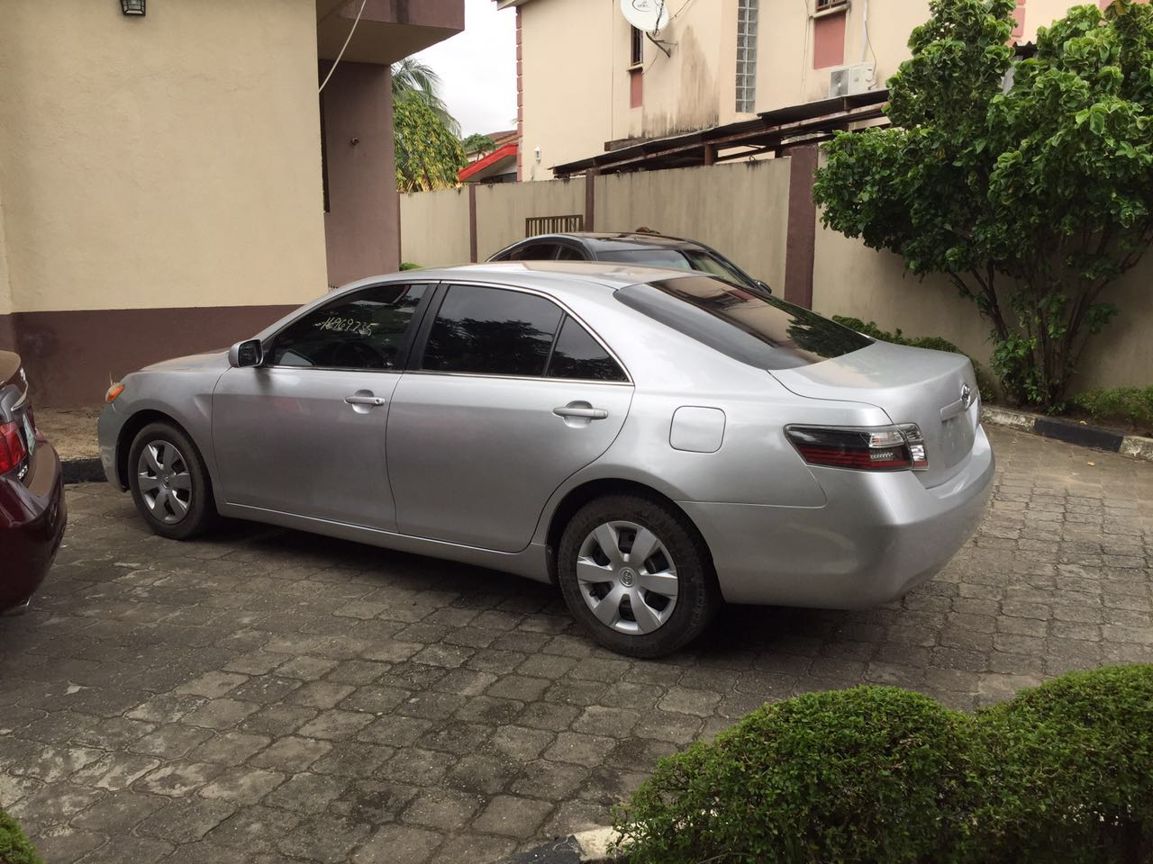 Very Clean, Unregistered Toyota Camry LE Silver Exterior Grey Fabric  Interior Tinted Windows Regular Stock Rims + Wheel Covers. Mileage   114,113