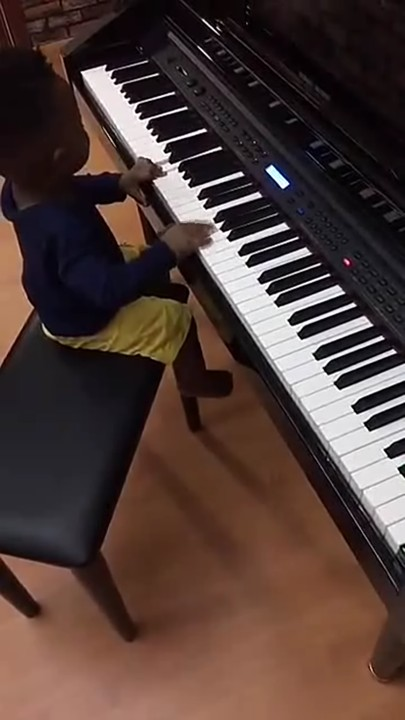 Olamide Teaching His Young Son How To Play Piano..