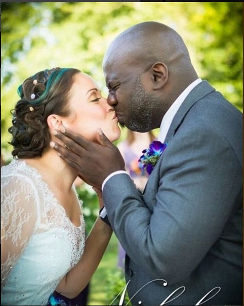 The Face Of This Groom Kissing His Bride Has Got Internet Users Confused.