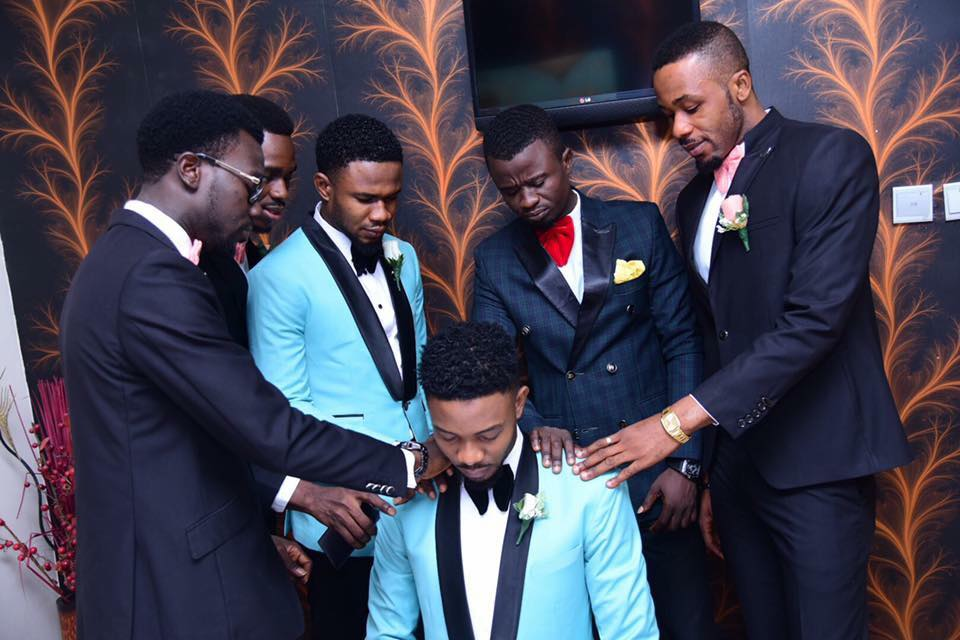 Adorable Photo Of Groomsmen Praying For A Groom Before His Wedding