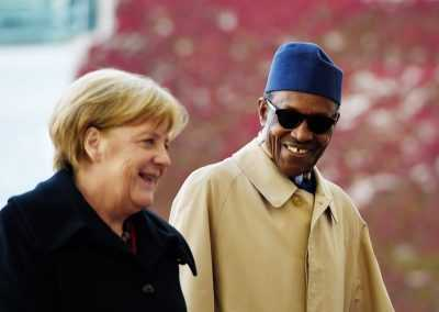 Buhari And Merkel Laughing Off Aisha's BBC Interview (Photos)