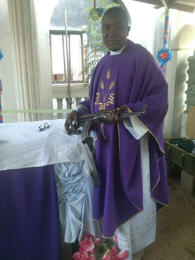 Rev Father Poses With His AK47 In Church, Probably Waiting To Kill Any Fulani Herdsmen