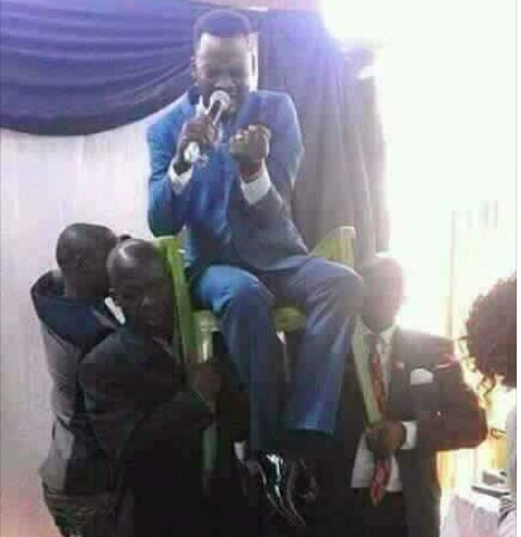 Church Members Carry Their Pastor On A Chair During Deliverance Session. Photo