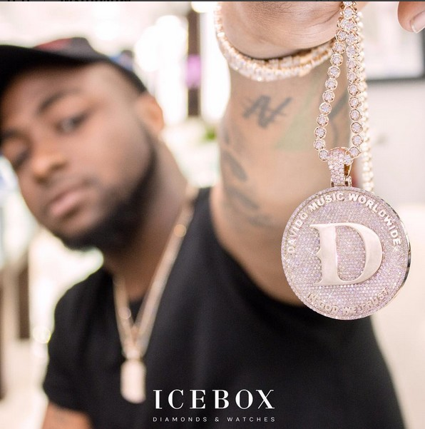 Image result for Davido shows off his expensive, diamond-encrusted accessories and dollar bills