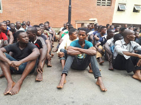 Arrested Badoo Gang Suspects Getting Screened By Police