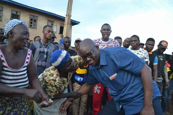 Fayose being Greeted by two women during project inspection at Okesa (Pics)