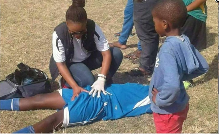 Photo Of A Female Paramedic Attending To A Male Footballer Goes Viral