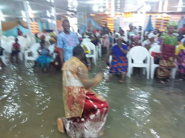 Photos Of Delta Pastor & His Members Worshipping In Waterlogged Church
