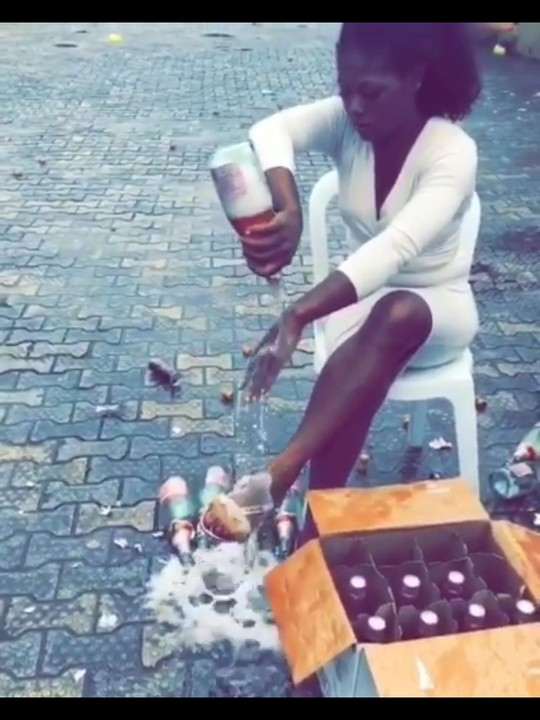 Slay Queen Pops 100 Bottles Of Andre Wine On Her Body After Graduation (Pics, Video)