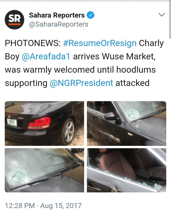5818262 cymera20170815140718 jpegd476a8c9b6b8e3d73ba8e7cbb9116626 - Resume Or Resign: Buhari Supporters Attack Charly Boy At Wuse Market, Destroy Cars (Video/Photos)