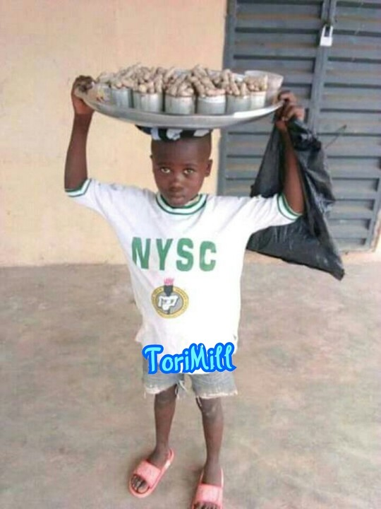 Photo Of Little Boy Wearing NYSC Uniform To Hawk Groundnut Goes Viral
