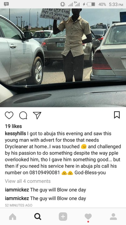 Man Advertises His Dry Cleaning Service In Abuja Traffic (Photos)