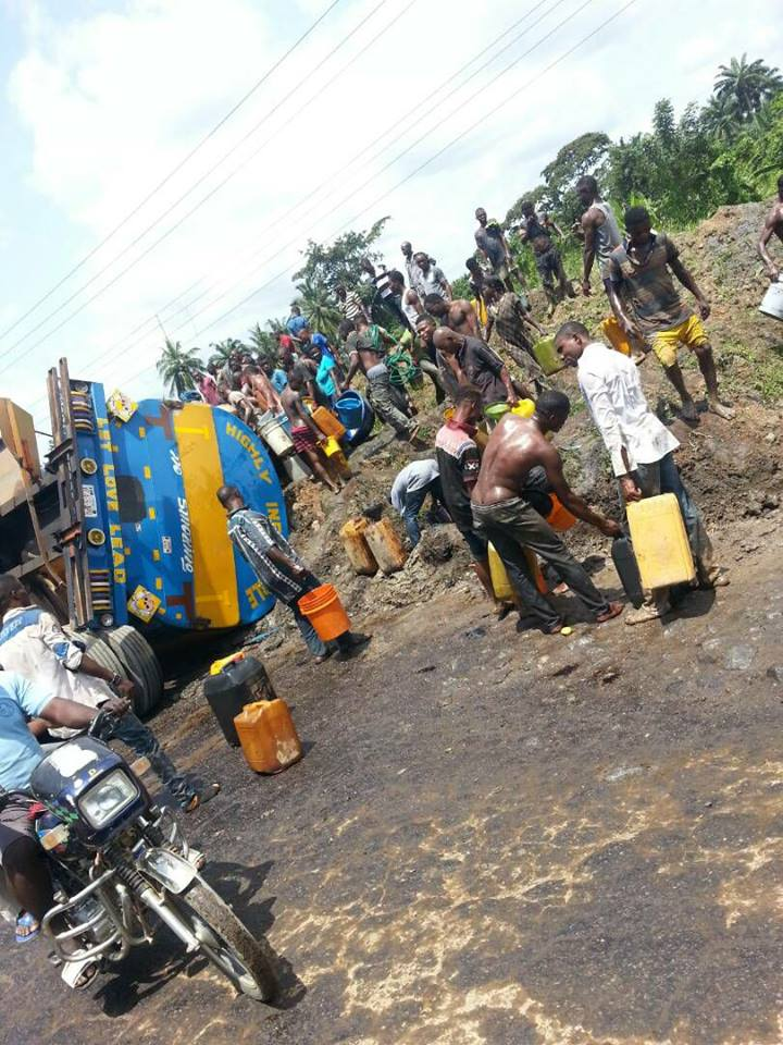 Fuel Tanker Falls In Cross River, Residents Rush Out With Their Gallons. Photo