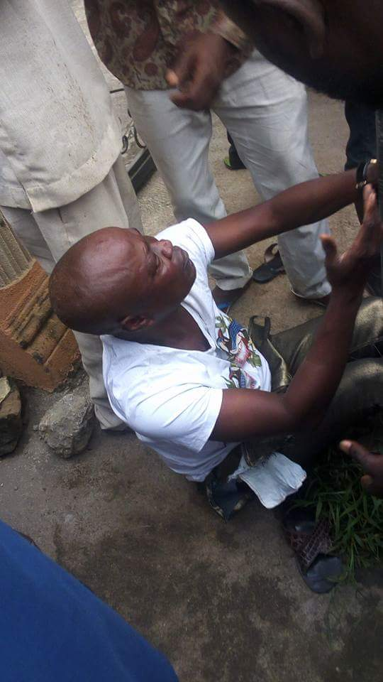 Lady And Men Who Robbed A Woman In Lagos Caught & Beaten By Mob (Graphic Pics)