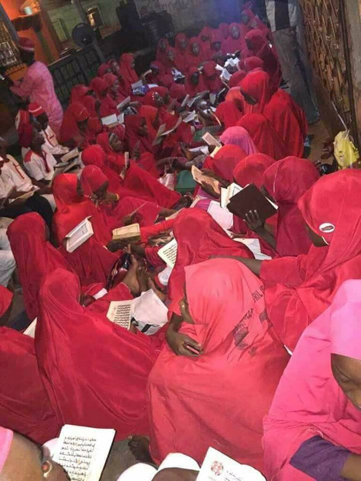 Youths Reading Quran Dressed Red & White Attires. Photos Spark Online Debate