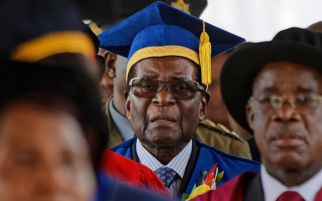Zimbabwe Coup: Robert Mugabe Attends Graduation In Cap & Gown, In 1st Appearance