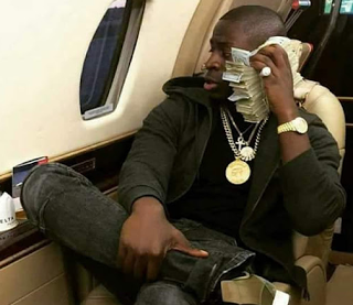 See Photos Of Son Of Incoming President Of Zimbabwe Flaunting Cash & Luxury Car