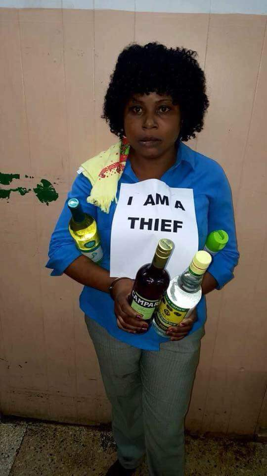 "Lady Wears ""I Am A Thief"" Tag For Stealing Wines At A Shopping Mall (Photo)"