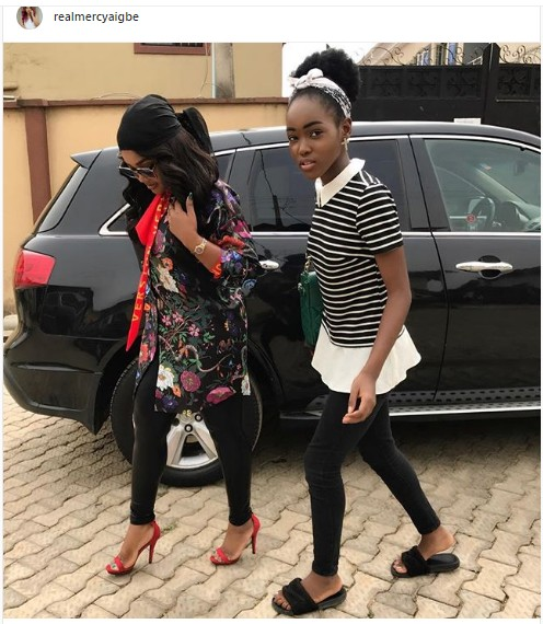 Mercy Aigbe Walk with her child. (The Queen and her…