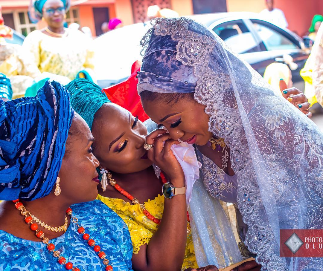 Pretty Bride Cries As She Kneels Before Her Mother In Adorable Wedding Photo