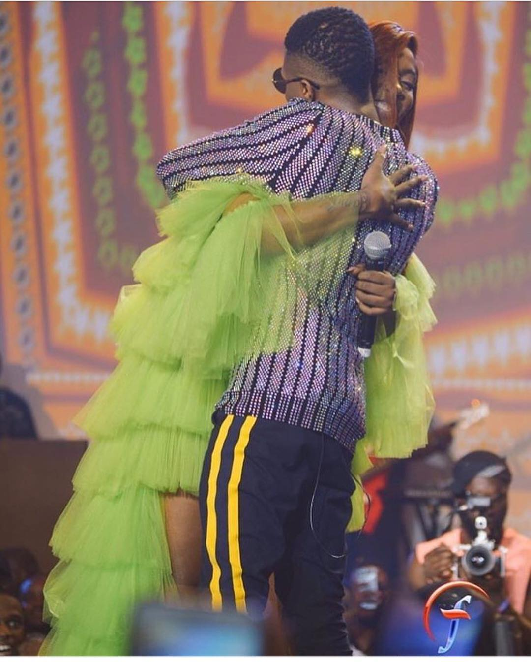 Adorable Moment At Wizkid Concert As Tiwa Savage Hugs Wizkid Tightly On Stage