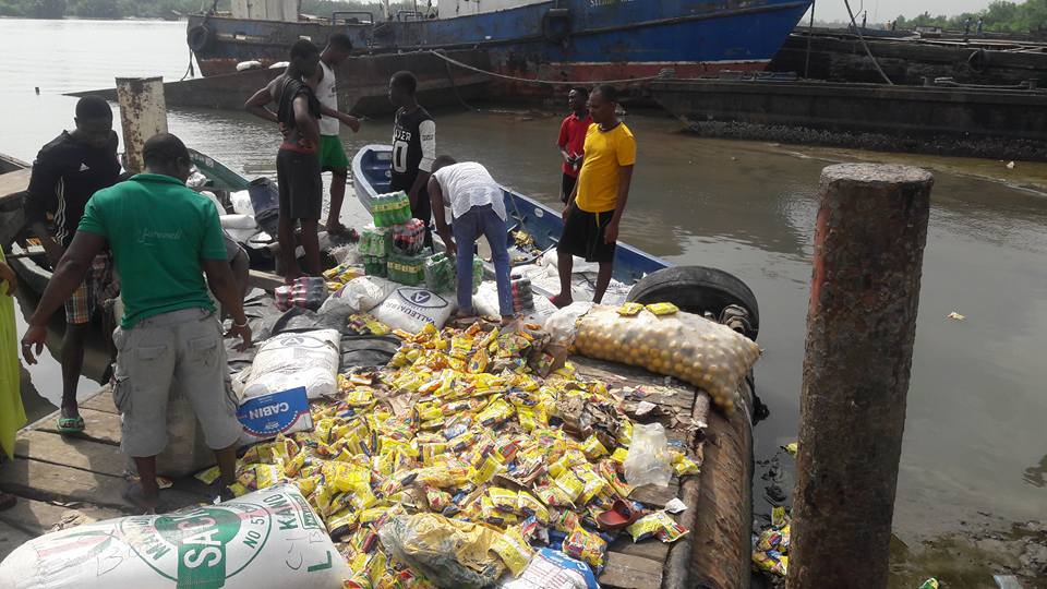 N5m Goods From Cotonou Destroyed As Boat Capsized At Bonny Jetty In Rivers State - Pictures