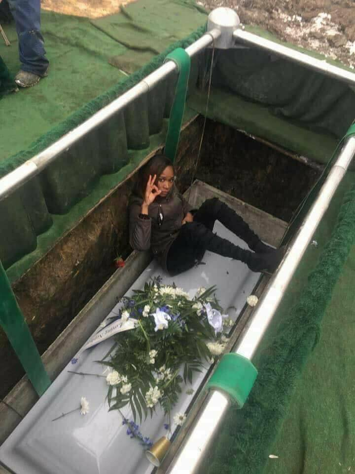 Ugandan Slay Queen Poses On Her Mother's Coffin In Her Grave During Burial (Pics)