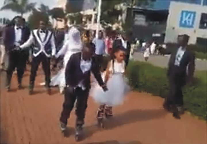 Bride And Groom Arrive Their Wedding Reception On A Skating Board In Rwanda