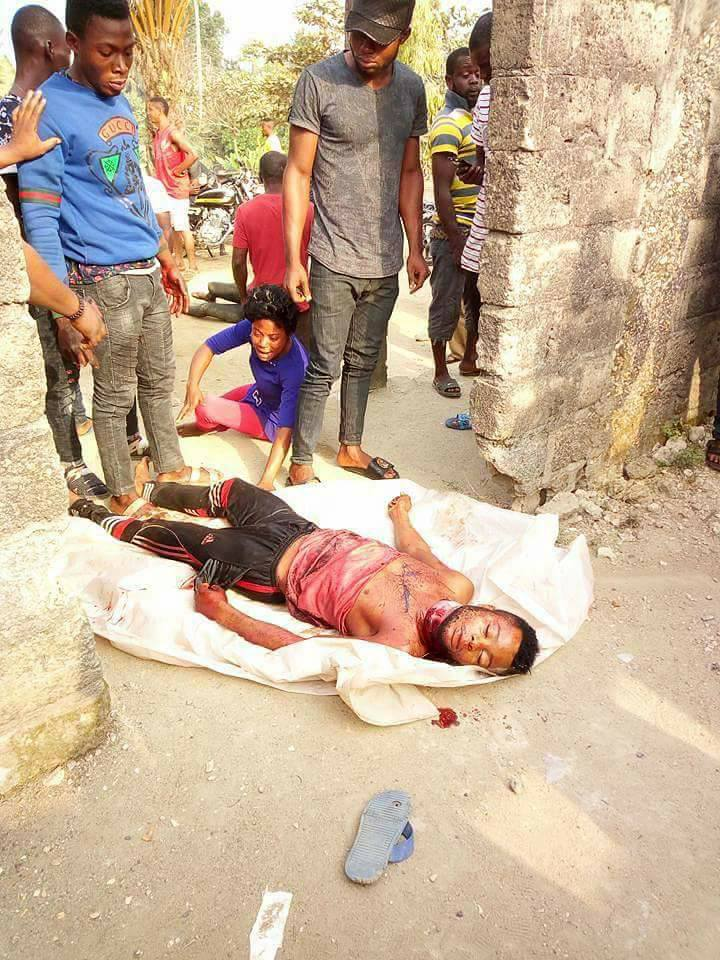 Young Man Gruesomely Murdered And Dumped On The Road In Calabar (Graphic Photos)