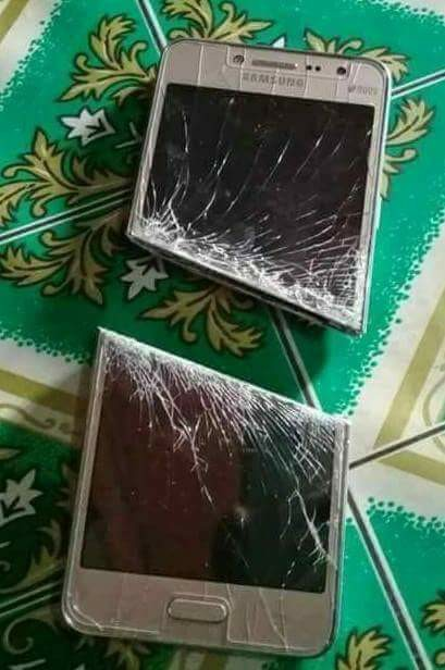 Husband Damages Wife's Phone With Cutlass For Not Telling Him Her Password (Photo)