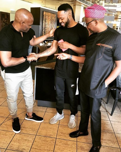 Photo Of Tony Elumelu Checking Out Flavour's Tattoos